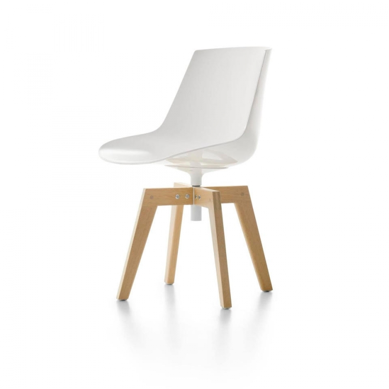 FLOW IROKO INDOOR and OUTDOOR CHAIR by JEAN-MARIE MASSAUD, designed in 2020. FLOW, icon of MDF Italia collection, renews itself and, thanks to the Iroko wooden base, it is also suitable for outdoor spaces. FLOW CHAIR IROKO also meets the various design needs for contract, hospitality, and restaurant business. The swivel 4-legged base, is made of solid IROKO, a very dense African wood, highly resistant to bad weather, light and extremes of temperature. A characteristic of thus wood is its smooth, even surface. All parts made of IROKO are treated using an exclusive varnish, specifically for outdoor use.